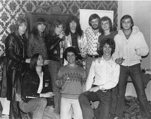 Back row, L to TR: Brian Connolly, guitar player Andy Scott, bass player Steve Priest, and drummer Mick Tucker of Sweet, Jim Hawn, branch manager, Capitol Records/Cleveland; John Gorman, Kid Leo.  Front: Matt the Cat, Bruce Ravid, Capitol Records, Steve Lushbaugh.  Photo taken at Swingo's Keg & Quarter after Sweet's Allen Theater concert in 1975.